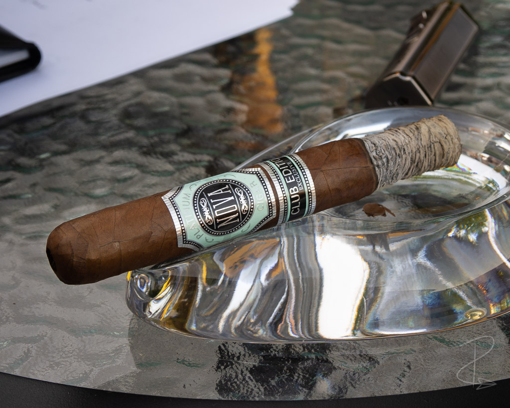 a half smoked Nova Platinum Club Edition Exclusive Toro cigar sat in my ashtray whilst I compose my cigar review
