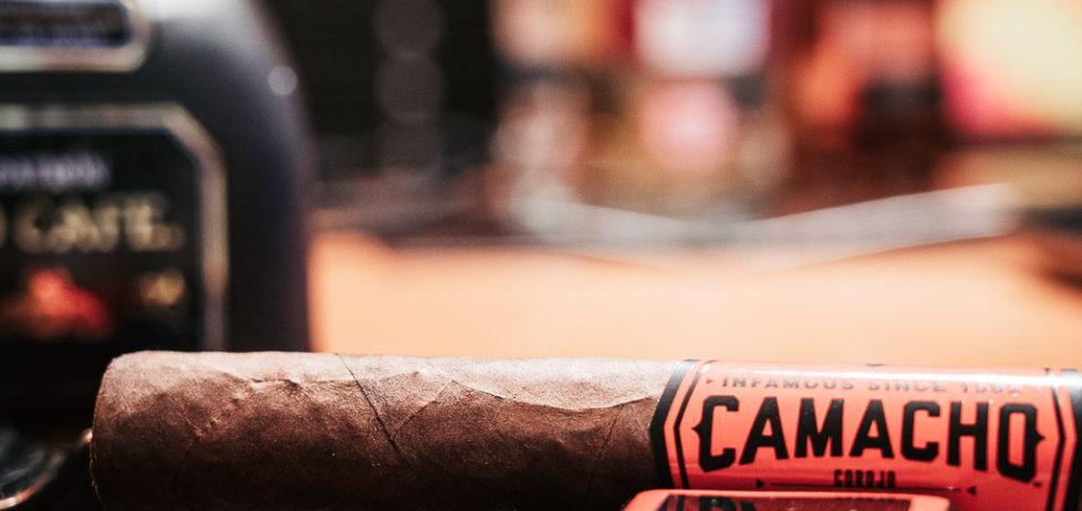 A Camacho Corojo Figurado cigar siting in my ashtray waiting to be lit