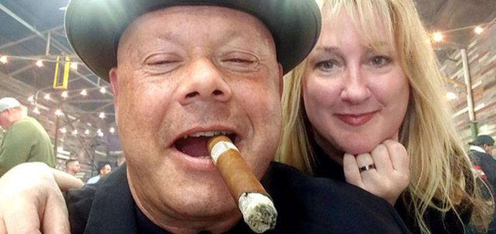 Al Roman enjoying a good cigar with Melissa Roman