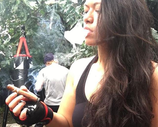 UKSOTL Syafiera enjoying a post workout cigar