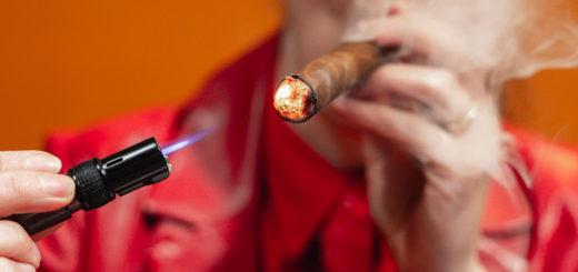 Lighting up a Villa Zamorano Churchill cigar