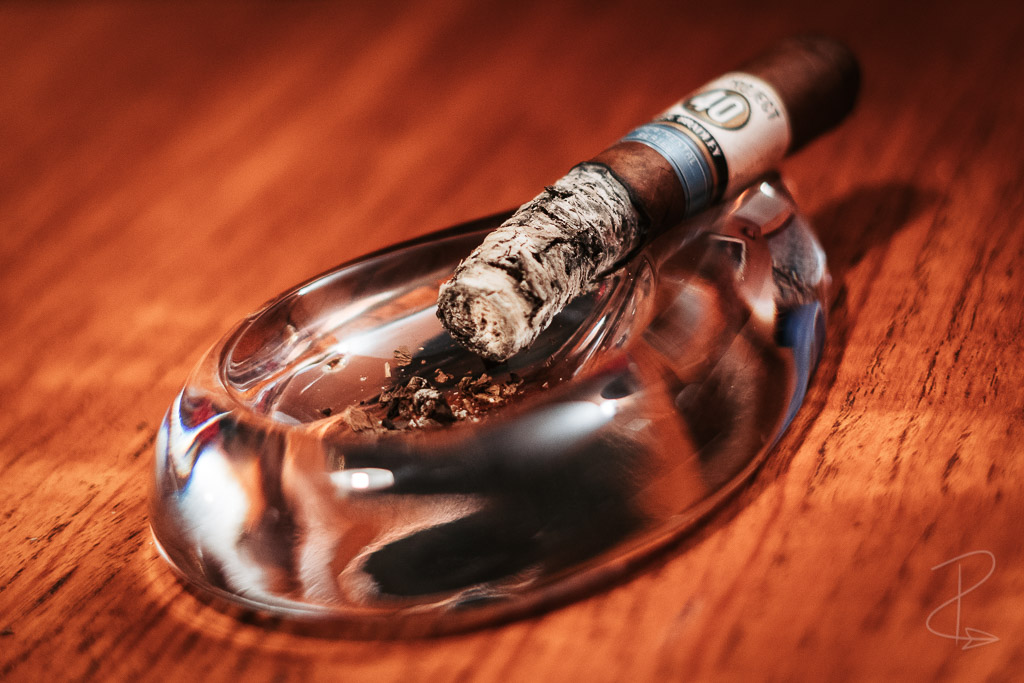 The Alec Bradley Project 40 Robusto cigar sitting in my ashtray