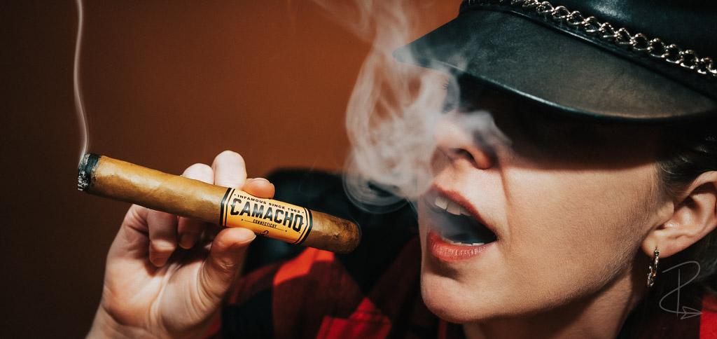 Pandora smoking one of her Camacho Connecticut cigars