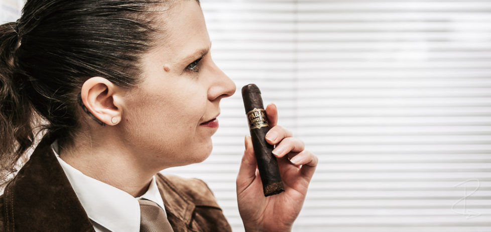 Sniffing the chocolate and coffee aromas from a Drew Estate Tabak Especial Robusto Oscuro cigar