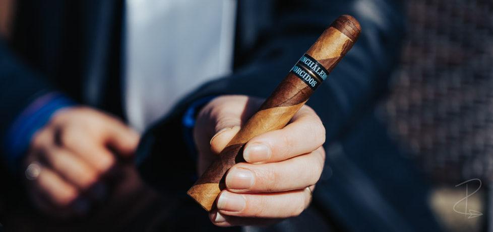 A Chinchalero Torcidos Tres Petit Corona barber pole cigar