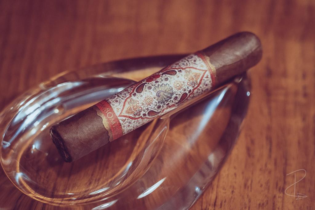 An unlit MBombay Habano Robusto cigar sat in my ashtray