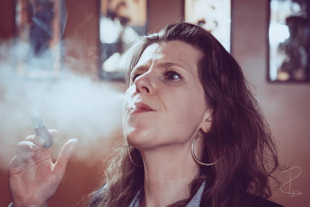 The thick and voluminous smoke from a MBombay Habano Robusto cigar