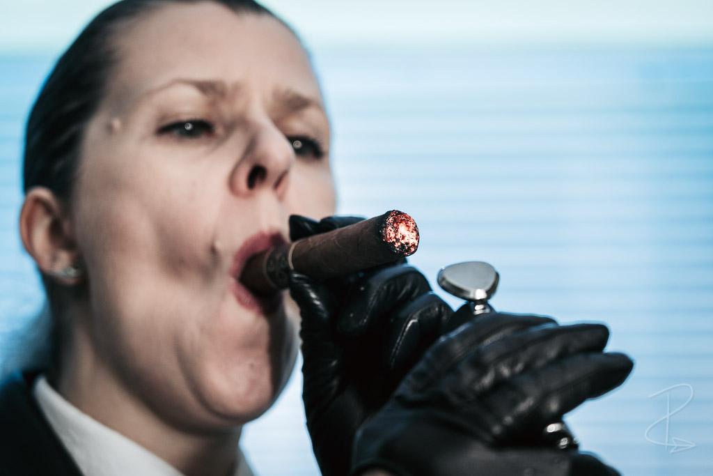Lighting up a Regius Robusto cigar
