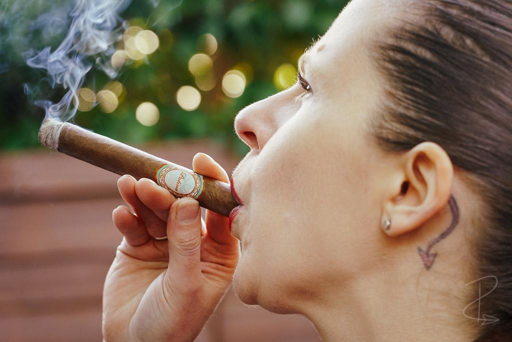 Taking a good draw on the Patina Habano Copper Corona Gorda Cigar