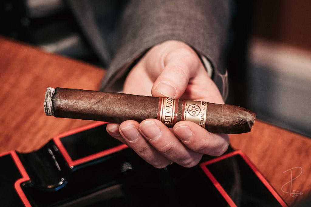 A freshly lit Rocky Patel Royale Torpedo cigar