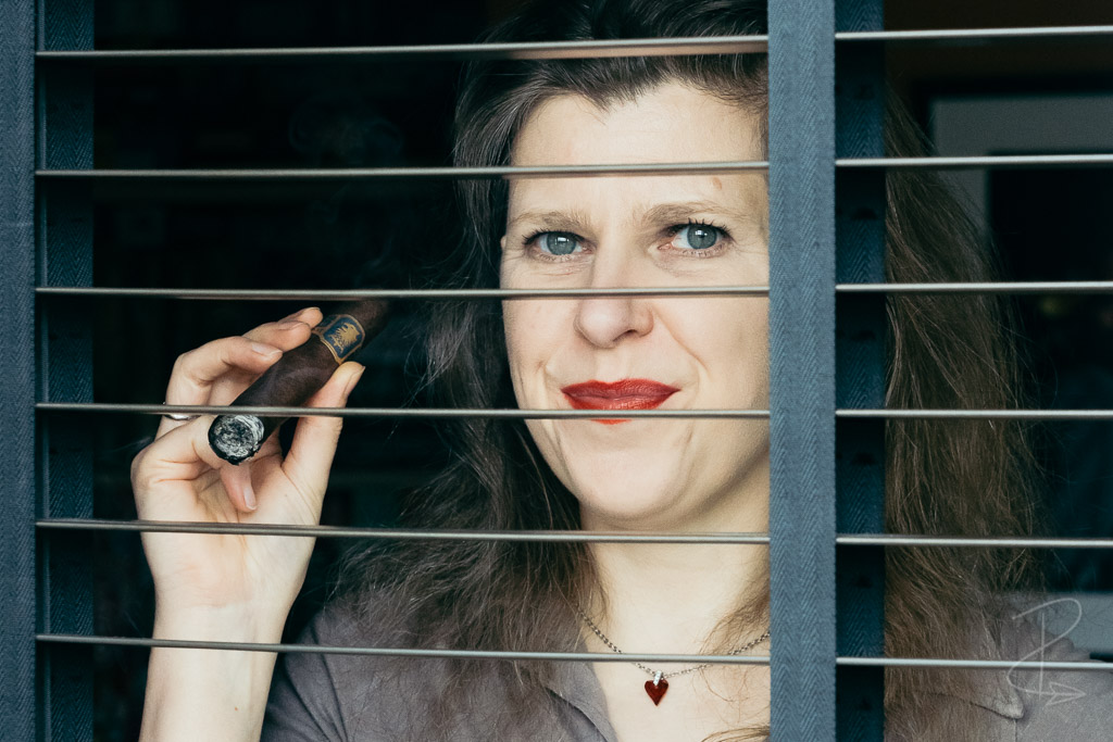 Looking out of the window taking the first draws on a Liga Undercrown Maduro Robusto cigar